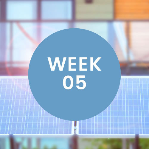 """Solar panels. A blue circle with """"Week 05"""" is in center of photo."""