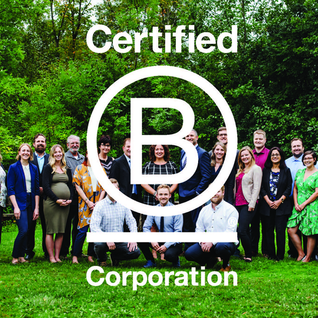 Group photo of smiling employees behind Certified B Corporation logo.