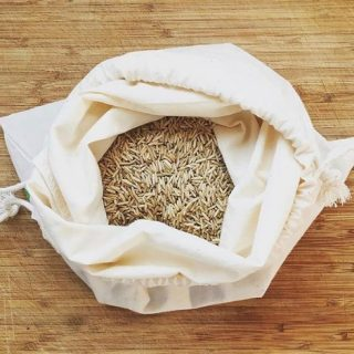 Rice in a bag sitting on a cutting board.