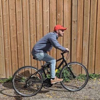 AET employee riding a bike.